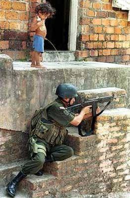 http://karfreitagsgrill.files.wordpress.com/2013/06/boy_pisses_soldier.jpg?w=342&h=522